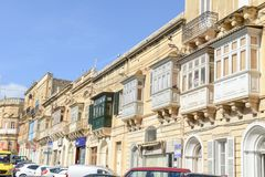 Traditional balconies of houses in Victoria on Gozo island. Victoria, Malta - 30 October 2017: Traditional balconies of houses in Victoria on Gozo island Royalty Free Stock Images