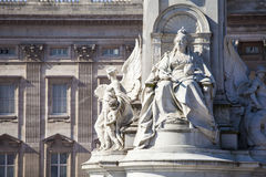 Victoria Memorial and Buckingham Palace in London. A view of the Queen Victoria Memorial Monument in London with the facade of Buckingham Palace in the Royalty Free Stock Image