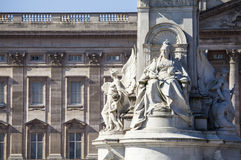 Victoria Memorial and Buckingham Palace in London. A view of the Queen Victoria Memorial Monument in London with the facade of Buckingham Palace in the Stock Photo