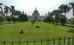 Victoria memorial Calcutta India. Green lawn infront of Victoria memorial stock images