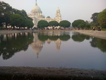 Victoria memorial. Day time shot in crowd, water reflection Stock Photos