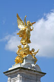 Victoria Memorial, London UK. The gilded Winged Victory at the top of Victoria Memorial, London, UK Royalty Free Stock Photography