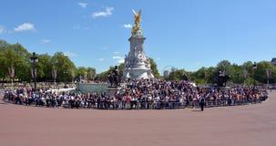 Victoria Memorial, London UK. LONDON, UK - MAY 13 2015: Visitors in Victoria Memorial, London, UK. At nearly 25 metres (82 ft) tall, the Victoria Memorial Stock Photos
