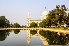 Victoria Memorial reflected in lake. Kolkata Stock Photos