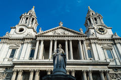 Victoria Monument, background St Pauls Cathedral. LONDON - 04 OCT 2015: Victoria Monument, background St Pauls Cathedral royalty free stock photo