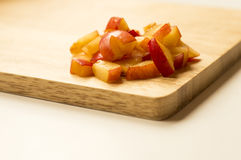 Victoria plum on cutting board. Ideal for wallpapers. Could be useful in presentations, web and printing design Stock Photography