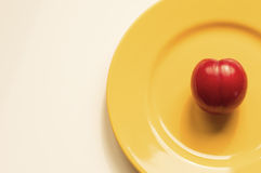 Victoria plum on a yellow plate Stock Image