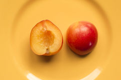Victoria plum on a yellow plate. Ideal for wallpapers. Could be useful in presentations, web and printing design Stock Photo