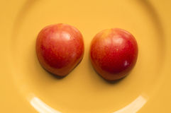 Victoria plum on a yellow plate. Ideal for wallpapers. Could be useful in presentations, web and printing design Royalty Free Stock Images