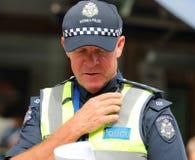 Victoria Police Constable fournit la sécurité pendant le défilé 2019 de jour de l'Australie à Melbourne photo libre de droits