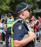 Victoria Police Constable fournit la sécurité pendant le défilé 2019 de jour de l'Australie à Melbourne photo stock
