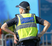 Victoria Police Constable som ger säkerhet på olympiskt, parkerar i Melbourne Arkivfoto