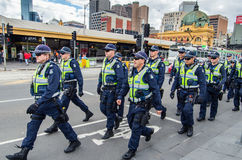 Victoria Police officers on Flinders Street in Melbourne Stock Photography