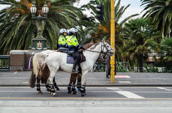 Victoria Police officers on Flinders Street in Melbourne Stock Photos