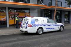 Victoria police officers interrogating a person. Victoria Police planing to buy 600 semi-automatic rifles in cost of about $25 million from state coffers royalty free stock photo
