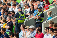 Victoria Police officers watching the crowd. Victoria Police officers watching a sporting crowd in Melbourne, Australia in 2015 royalty free stock photography