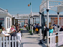 Victoria's Bar on Brighton Pier, UK. Tourists enjoying Victoria' Bar on Brighton Pier on June 16, 2009. Brighton Pier and Victoria's Bar are favorite tourist Royalty Free Stock Photo