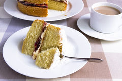 Victoria sandwich. A Victoria sandwich cake served with a cup of tea Stock Photography