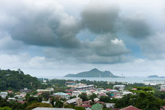VICTORIA, SEYCHELLES - MAY 9, 2013: Landcape from the mountain direct to Victoria and town port. Cloudy sky Royalty Free Stock Images