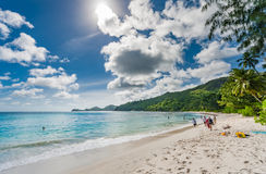 VICTORIA, SEYCHELLES - MAY 10, 2013: Publick beach in Seychelles with few tourists. Sunny day. Stock Image