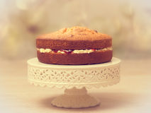 Victoria Sponge. Cake filled with jam and buttercream - antique vintage tone effect added Royalty Free Stock Image