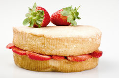 Victoria sponge cake with fresh strawberries on white background Royalty Free Stock Photography