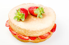 Victoria sponge cake with fresh strawberries on white background Stock Photo