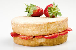 Victoria sponge cake with fresh strawberries on white background Stock Images