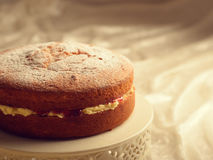 Victoria Sponge Cake. Freshly baked Victoria sponge cake filled with jam and buttercream Royalty Free Stock Photography