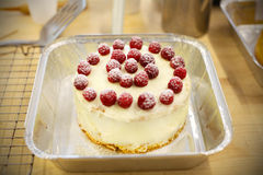 Victoria sponge cake with icing and raspberries Stock Photography