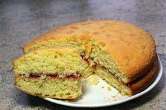 Victoria sponge cake. Separate piece cut off. Stock Image