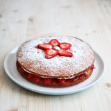 Victoria sponge cake with strawberries on a wooden Royalty Free Stock Photos