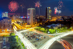 Victoria Square in Bucharest, Romania with fireworks in the sky. Stock Photography