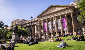 Victoria State Library in Melboure. Melbourne, Australia on May 5, 2016: Students relaxing at the State Library of Victoria Royalty Free Stock Photo