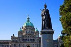 Victoria statue with British Columbia Parliament. Regal statue of Queen Victoria, Regina et Imperatrix, with British Columbia Parliament building, Victoria Royalty Free Stock Photography