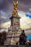 The victoria statue and the square outside Backighgam palace royalty free stock image
