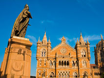 Victoria Terminus in Mumbai. Chhatrapati Shivaji or Victoria Terminus Train Station and Sir Pherozeshah Mehta statue in Mumbai, India Royalty Free Stock Photos