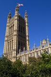 The Victoria Tower of the Houses of Parliament. The union flag flies on the Victoria Tower of the Houses of Parliament in London Royalty Free Stock Images