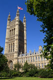 The Victoria Tower of the Houses of Parliament. The union flag flies on the Victoria Tower of the Houses of Parliament in London Stock Photography