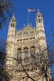 Victoria Tower of the Palace of Westminster Through Trees Royalty Free Stock Image