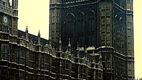 Victoria tower of Westminster in London. London, United Kingdom - Circa 1977: Victoria Tower of Westminster with Richard Coeur de Lion statue in old Palace Yard stock footage