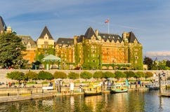 Victoria Waterfront and Empress Hotel at Sunset. Victoria, BC, Canada - July 4, 2014: The Waterfront and Empress hotel at Sunset. The Empress, located in front Stock Photography