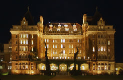 Victorian architecture. A night time view of a splendid old Victorian building with glowing golden lights Stock Photo
