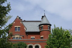 Victorian architecture with spiral turret and front gable Royalty Free Stock Images