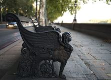 Victorian bench on the sidewalk footpath of the River Thames. Autumn cityscape royalty free stock photos