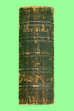 Victorian bible. The spine of an old Victorian bible printed in 1868 on a green background Royalty Free Stock Images
