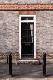 Victorian black external wooden door with glass panels on a clas Royalty Free Stock Photos
