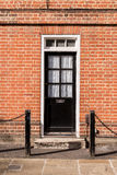Victorian black external wooden door with glass panels on a clas Royalty Free Stock Photography