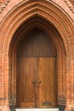 Victorian Brick Archway. Detail of an ornate Victorian brick archway and wooden door of a church Royalty Free Stock Images
