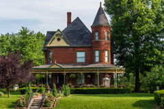 Victorian Brick Bed and Breakfast Home. Queen Anne archictecture with beautiful landscaping in Lexington, Missouri Royalty Free Stock Photo